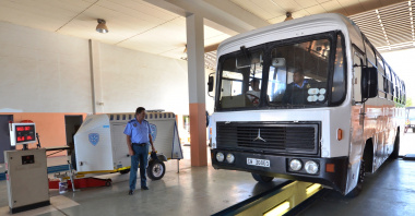 Traffic officers inspect a bus at the Breede River traffic testing centre.