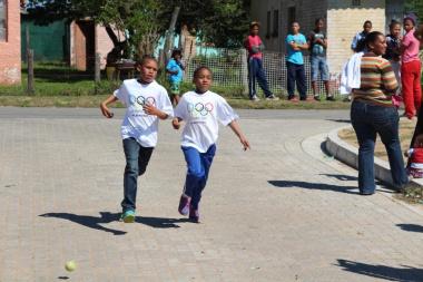 Two learners finishing the 4 km fun run