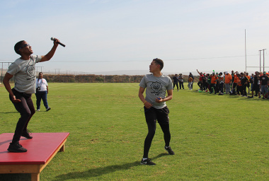 Two SANDF members lead the participants through an aerobics session before the start of competition.