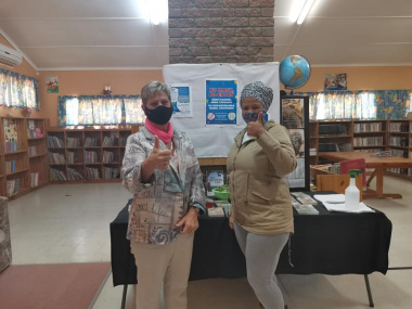 Minister Marais with Grizelda Brandt at Uitkyk Library in Lutzville. More photographs are available upon request.