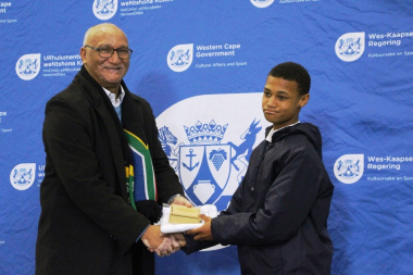 Under-13 long jump champion Jean-Pierre Snell being awarded for his achievements