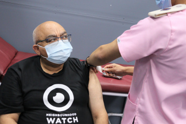 Minister Albert Fritz gets the COVID-19 vaccination.