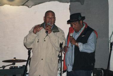 Vernon Vraagom and John Cloete sharing a story.