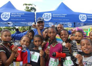 Very proud children from our MOD Centre programme showing off their medals after completing the Lion of Africa 10km walk