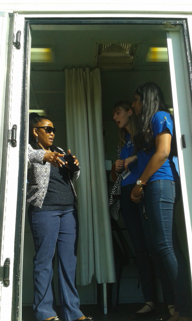 Minister Mbombo with UCT students on SHAWCO mobile clinic