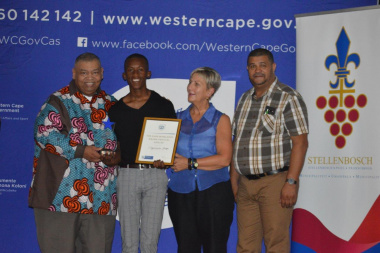 Vuyolwethu Tanga (second left) receives the Best Actor award from Minister Anroux Marais