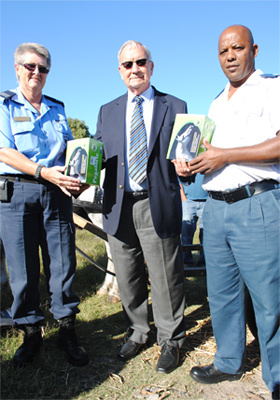 Minister Van Rensburg flanked by Diana Truter and Clive Matthews.