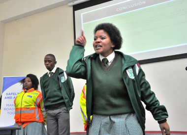 Wandisile Katise of Nomzamo High School leads a dramatic project presentation.