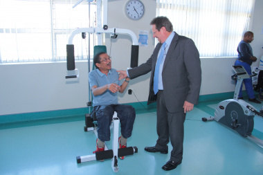 Minister Theuns Botha speaking to one of the patients at the Western Cape Rehabilitation Centre.