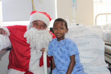 Sibonile Sibulele receiving a gift from Father Christmas.