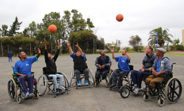 Wheelchair basketball athletes show their excitement on the court.