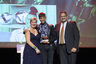 Kirvin Fortuin (centre) receives an award from minister Anroux Marais (left) and DCAS HOD, Brent Walters.