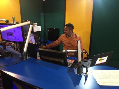 Xolisa Sindaphi airing the prayer service at Zibonele FM