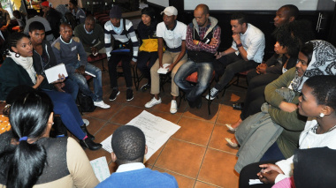 Young people actively debating road safety issues and possible solutions.