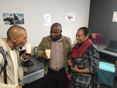 Young people enjoy coffee in the Youth Hub