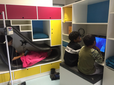 Brothers, Rameez (right) and Rafieq, watch a movie while Zyaan relaxes in the pod while receiving treatment.