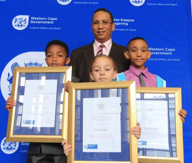 Youth champions Hilalane Varara, Natasha Joubert and Seth-Riley Adams with Minister Ivan Meyer.