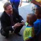 Minister Botha gets down to kiddie height to talk to the children.