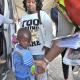 A small boy receives a reflective wristband to help keep him safe.