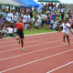 Athletes competing on the new athletics track