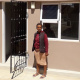 Ms Thandiswa Magadla a beneficiary from Mfuleni standing in front of her new house