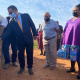 Minister Meyer being watched by PT Hahn and minister Didiza as he switches on the irrigation system