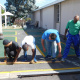 Hard at work: From left Timothy James, Khalib Hendricks, J C Ongansie and David Leonard