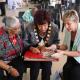 Rachel Beerwinkel shows Minister Marais and Mayor Gesie van Deventer old photos