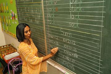 teacher-writing-on-a-chalkboard_1