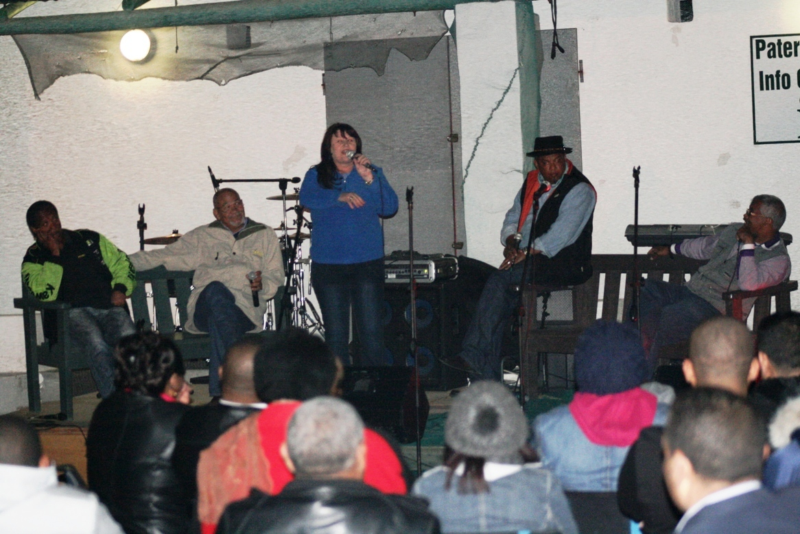 The storytelling performers on stage.