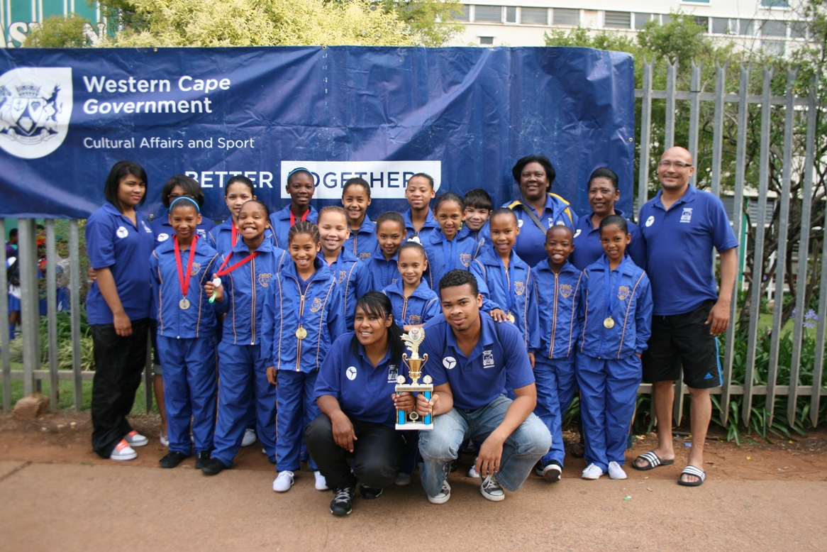 The u13 Wavecrest Primary School girls' team with their trophy and medals.
