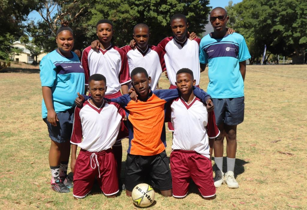 The youth category's winning team from Kayamandi Secondary School with their coaches.