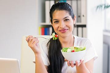 woman enjoying a salad