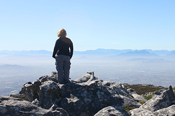 woman enjoying the view on top of table mountain