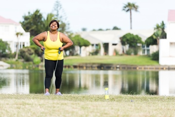 Woman exercising outdoors with water background