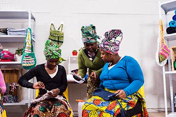 Female entrepreneurs checking info on the tablet