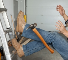 Worker falling from a ladder with a hammer hanging in the air